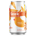 Apricot + Mango can, orange curled teardrops in the background with darker orange flower shapes in the foreground.